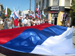 Crimean people celebrate reunification with Russian happy celebrations big Russian flag